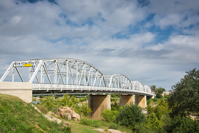 Roy B. Inks Bridge—named for a former mayor of Llano and built in 1936.  It replaced an earlier 1892 truss bridge that was swept away by a 42-foot flood crest in 1935.  The Inks Bridge was designed in late 1935 and is composed of four 200-ft Parker Truss spans and was opened to traffic in 1936.  The bridge features the original west side pedestrian walkway with lattice railings and all-riveted construction typical of the 1930s.  In 2006, a new, wider pedestrian walkway was added to the east side in conjunction with a bridge rehabilitation project.