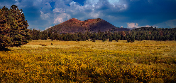 Sunset Crater, Arizona. Sunset Crater is the youngest in a string of volcanoes (the San Francisco volcanic field) that is related to the nearby San Francisco Peaks. It first erupted in 1064, and the last major eruption occurred in 1180, raising the volcano's height to about 1000 feet.