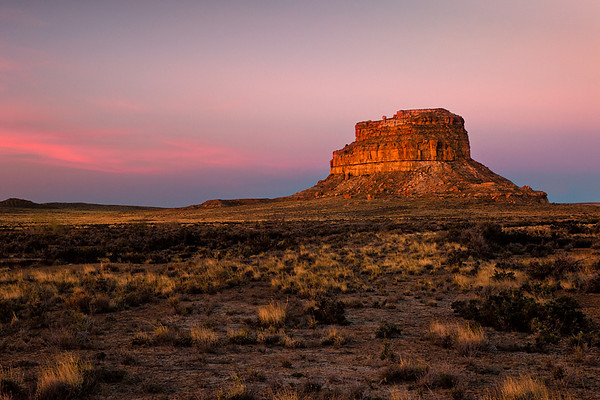 """Fajada Butte, Chaco Culture National Historical Monument. The butte is home to the famous Chacoan astronomical marker known as the """"Sun Dagger"""", found high on a shoulder of the formation. Three vertical slabs of sandstone lean against a cliff. They are aligned so that a thin """"dagger"""" of light shines through the slabs and onto the cliff face at noon each day. Two spirals were carved into the cliff face. At noon on the summer solstice, the light falls on the middle of the larger spiral. At the winter solstice, two shafts of light bracket the outer edges of that spiral. At spring and autumn equinoxes, a smaller shaft of light bisects the smaller spirals. <br /> <br /> The area has been closed to visitation as scientists recently noted that the slabs have shifted and the light no longer aligns as it used to. It is suspected that human traffic is the cause."""