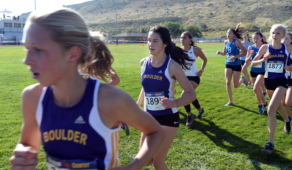 . LYONS, CO: September 8:  Stella Vieth, left, of Boulder, Izzy Heart, of Boulder, and Bettina Burgess, of Boulder, during the St Vrain Invitational Cross Country Meet. (photo by Cliff Grassmick/Staff Photographer).