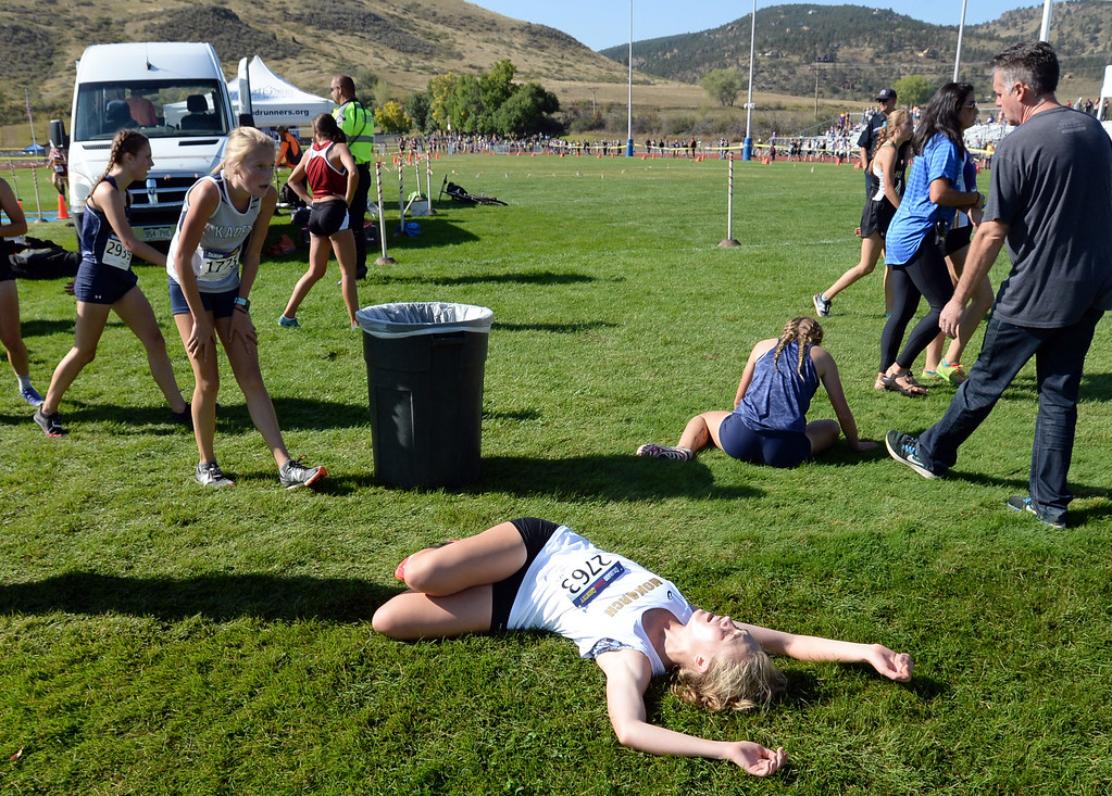. LYONS, CO: September 8: Madelyn MacLaughlin, of Monarch, collapses after the 4A/5A race  during the St Vrain Invitational Cross Country Meet. (photo by Cliff Grassmick/Staff Photographer).