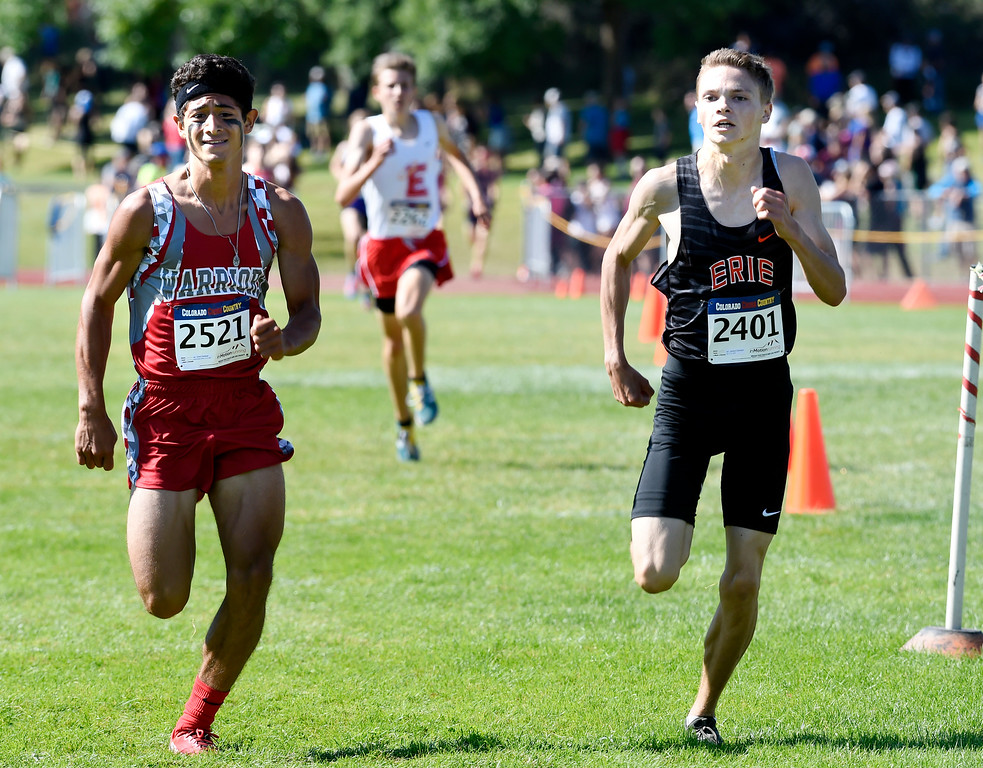 . LYONS, CO: September 8:  David Cardenas, left, of Grand Junction Central, and Jamison Cartwright, of Erie, during the St Vrain Invitational Cross Country Meet. (photo by Cliff Grassmick/Staff Photographer).