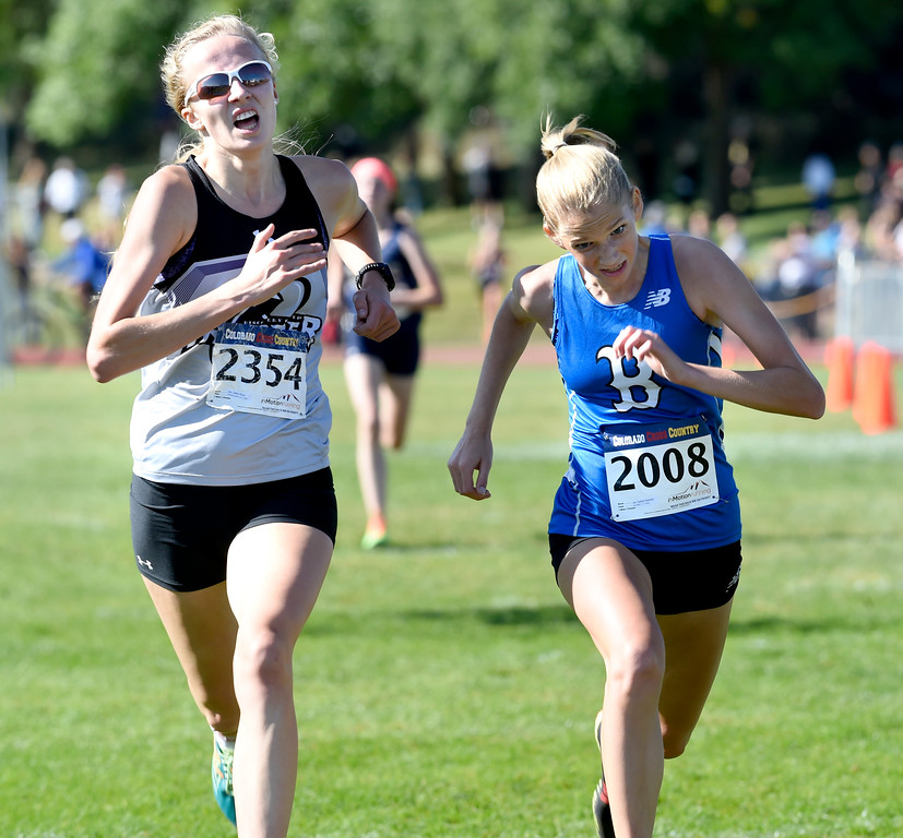 . LYONS, CO: September 8:  Sydney Swanker, right, of Broomfield, edges out Liberty Ricca, of Discovery Canyon, for the win in 4A/5A girls during the St Vrain Invitational Cross Country Meet. (photo by Cliff Grassmick/Staff Photographer).