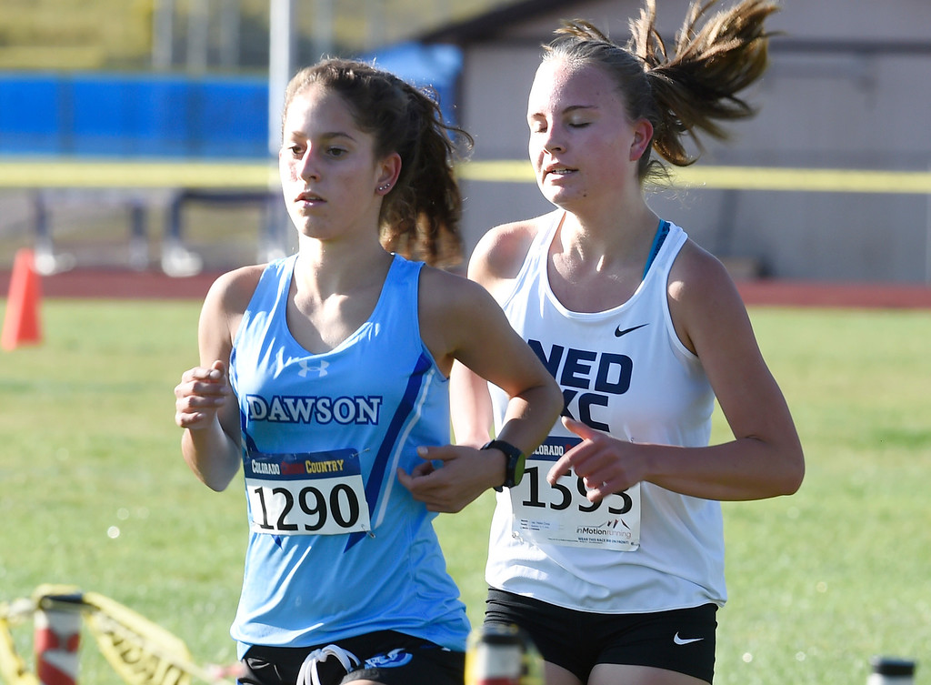 . LYONS, CO: September 8:  Lucca Fulkerson, left, of Dawson, and Helen Cross, of Nederland in the 2A/3A during the St Vrain Invitational Cross Country Meet. (photo by Cliff Grassmick/Staff Photographer).