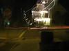 Xmas decorations and passing car at night