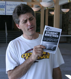 Tim holding 'Student Ministries for Dummies' brochure 7/9/2006