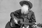 Adventurer and musician JOHN WAYNE at The Plaza, Historic Santa Fe, NM.
