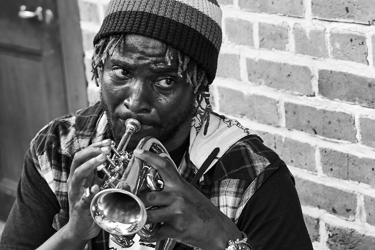Jazz trumpeter and street musician VERSE photographed on Rue Royal, New Orleans, LA.