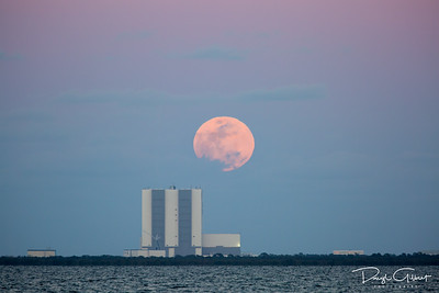 Snow Moon, In Partial Eclipse, Peeks Out Behind VAB