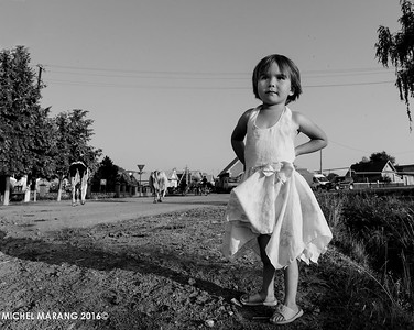 "Tatar village girl, waiting for ""her"" cow to come back from the fields."
