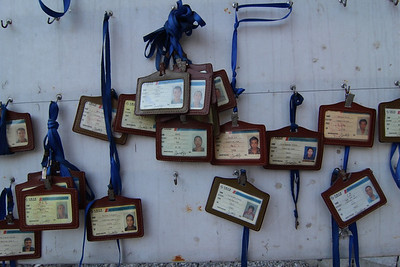 Worker identification cards hanging at the entrance to the powerhouse tunnel for the Upper Tamakoshi Hydropower Project - work on the tunnel system proceeds 24 hours per day, with over 400 laborers and engineers. Gonggar, Dolakha. 2013.