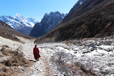 A lama from Chora Gepheling Monastery walking along the Lapche Khola, headwaters of the Tamakoshi River, near the edge of Tibet. In the coming years a 220MW project is being proposed just downstream from here. Lapche, Dolakha. 2013.