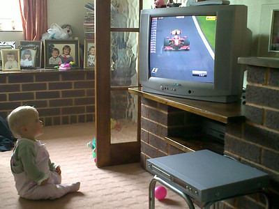 Bethany paying close attention to the grand prix.  Probably wondering if that's Rory the Racing Car on the screen.