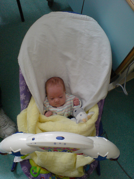 Bethany sitting in the bouncy chair.<br /> She looks really tiny compared to the chair.  Maybe the chair was huge?!