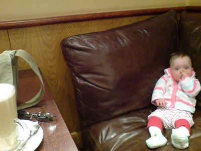Amelia settling in a Costa Coffee.  However much she wants the coffee on the table she's not having it !