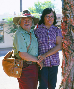 Albuquerque 1977  - The tree Madonna was carved by the old man who poses with his daughter.