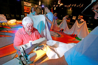 Susie Arkell, former president of the Kiwanis Club, woks on sewing the 300 yards of muslin to make the dress for the 49 foot Zozobra pupet on Aug. 24, 2010, at Warehouse 21.             Luis Sanchez Saturno/ The New Mexican.