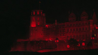 heidelberg-castle-in-glowing-red-light_MJeU3Ofd