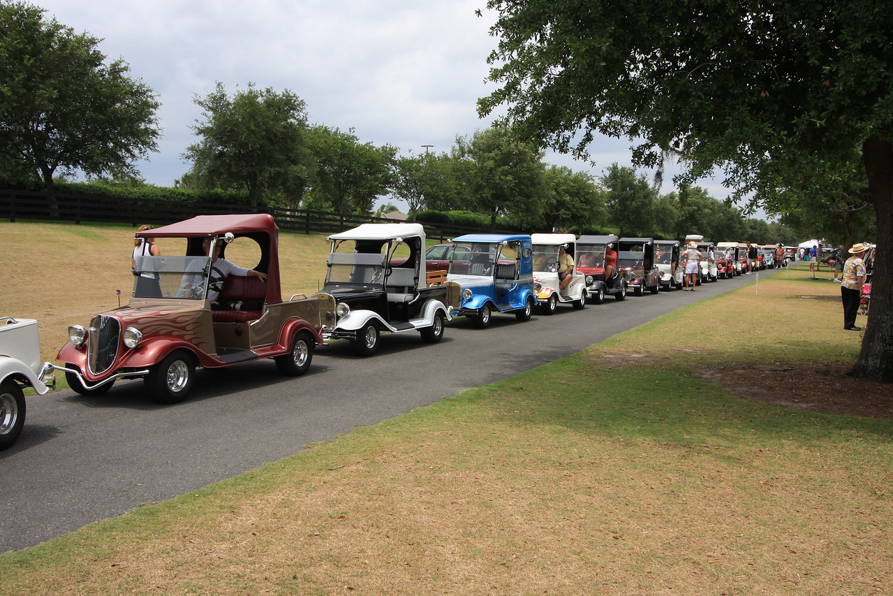 Streetrod golf carts lined up for a parade at half time during the Polo match.