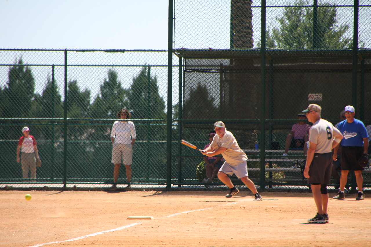 Note the ball in the lower left and the batter is headiing to first base!