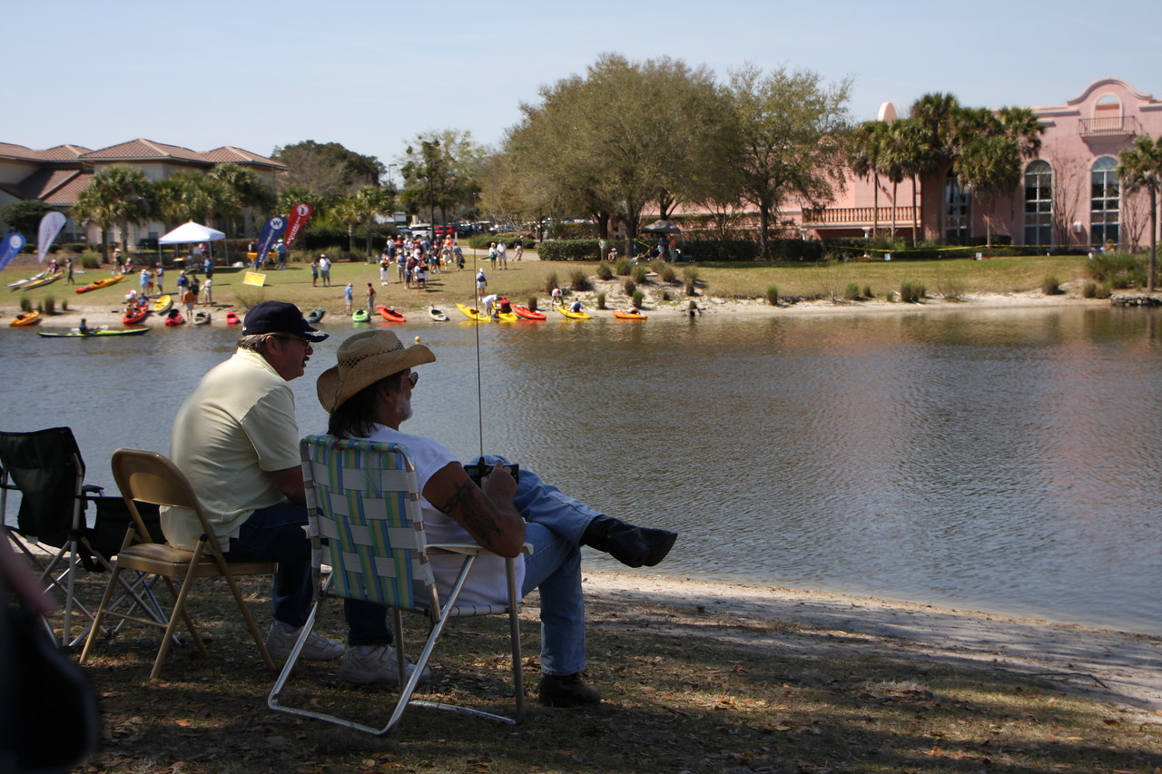 Members of the Villages RC club enjoying at afternoon under the shade tree with their boats