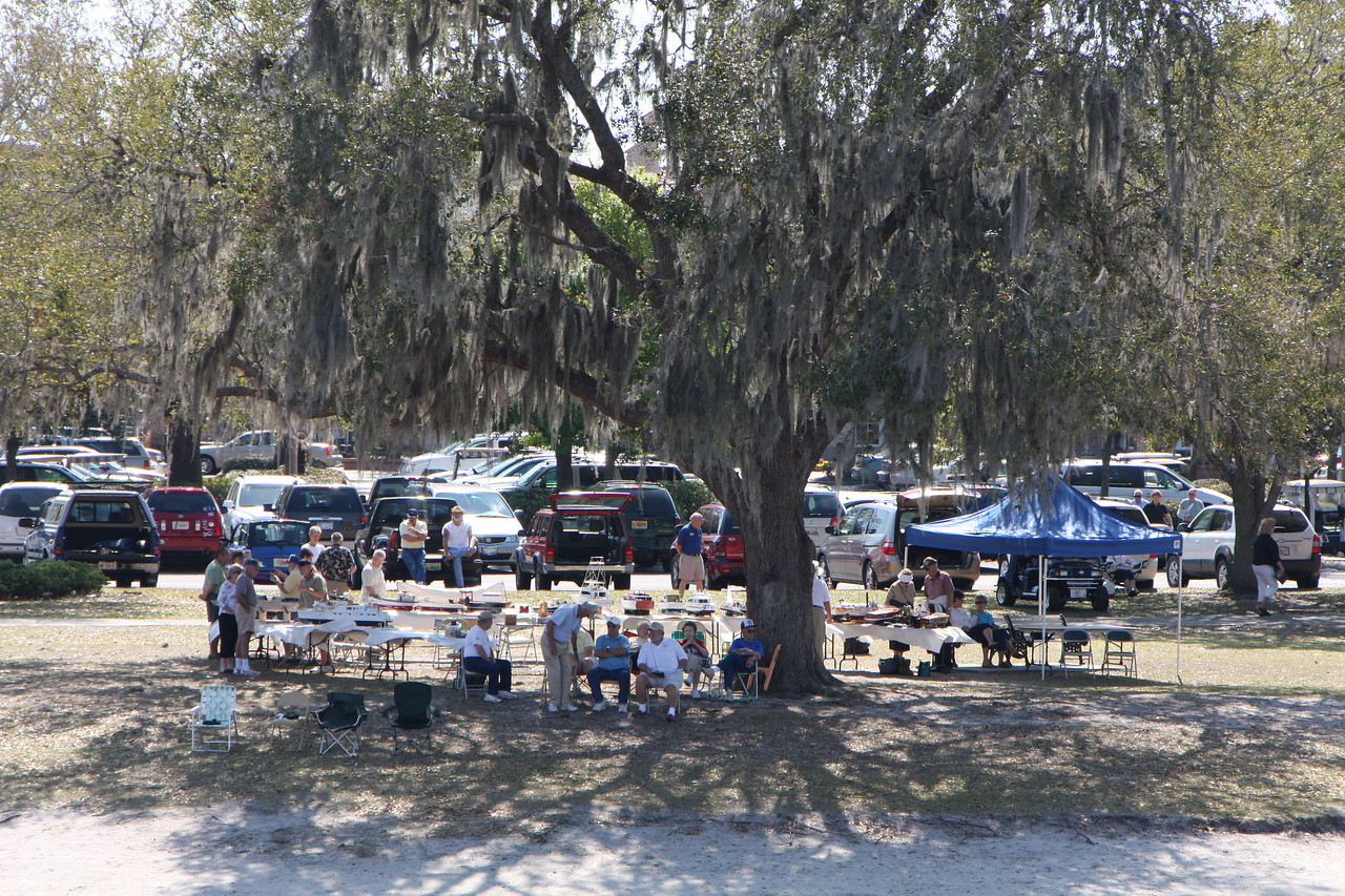 Villages RC club set up under the shade tree by the lake
