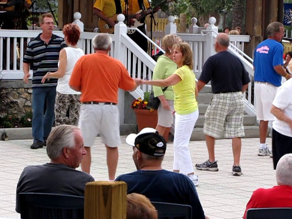 Rocky & The Rollers perform at Sumter Landing, in the Villages.  Different bands perform every night, 7 days a week, from 4PM to 9PM, at both Sumter Landing Town Square and Spanish Springs Town Square.  This is just one of the many forms of intertainment provided by The Villages for its residents.  It is all free, no charges.