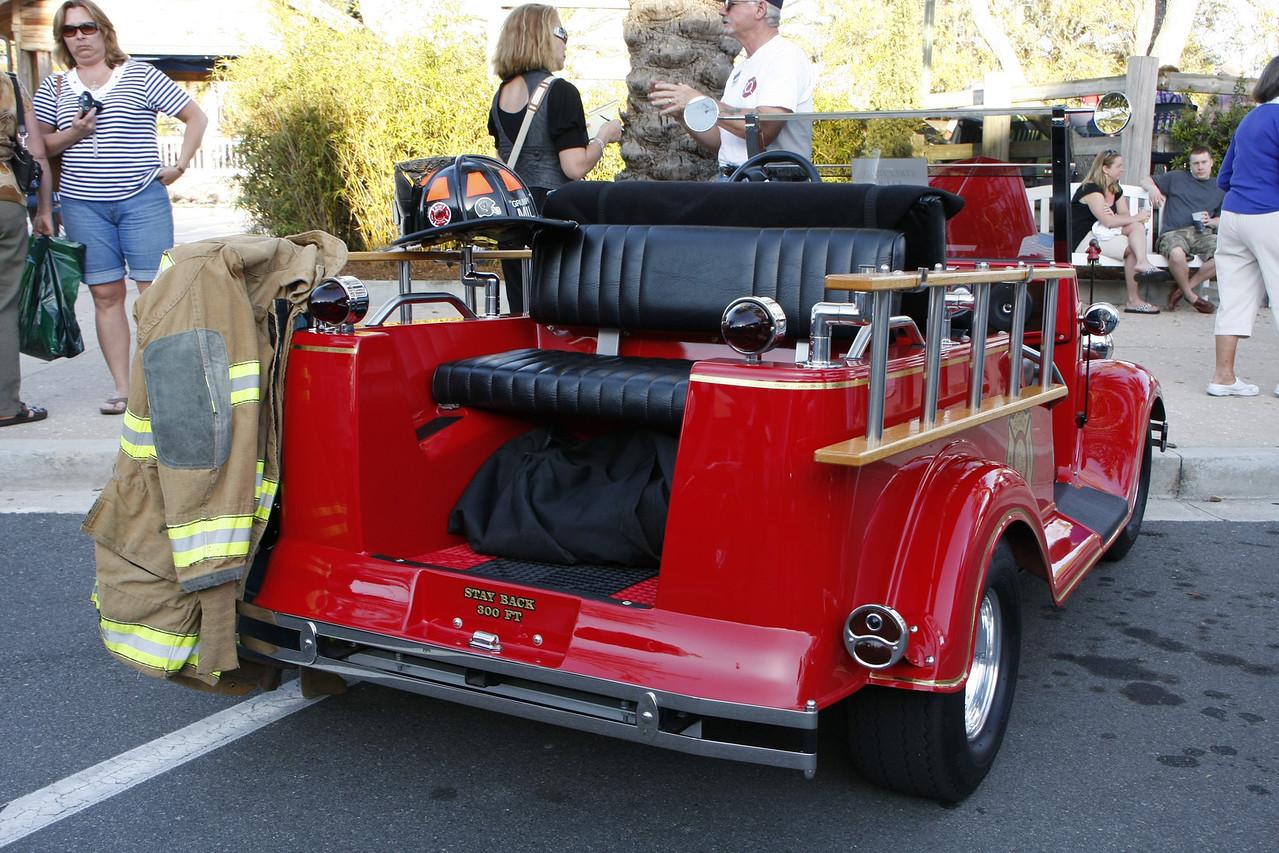 It is equiped with lights, siren, bells and whistles.  Everybody loves a fireman