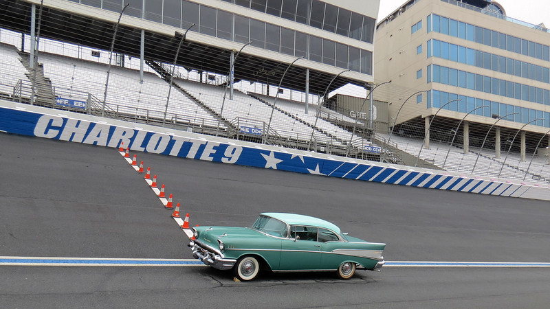 A beautiful 1957 Chevrolet Bel Air parked at turn 1 gives a good indication of just how steep a 24-degree banking is.
