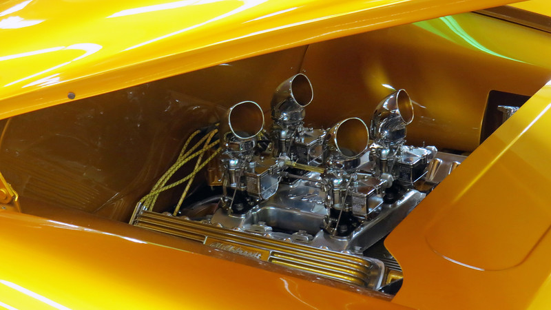 Instead of going the modern route with the engine, a 390 CID Cadillac V8 from 1959 was selected.  The Stromberg 97 carburetors sit atop an extremely rare Jot Horne intake manifold.