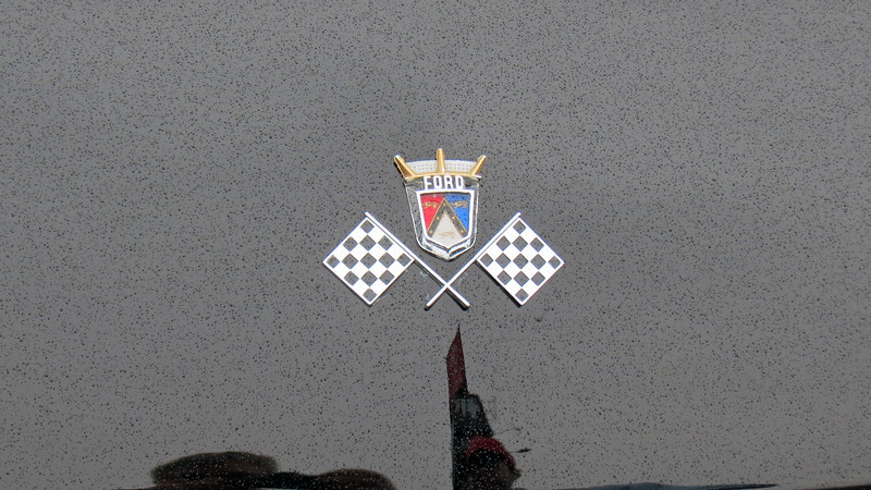 One of the subtle differences between a 1955 and 1956 Ford Thunderbird is the placement of the crossed checkered flags badge on the hood.  The 1955 T-Bird had the flags on the hood while the 1956 model did not, (they were replaced by Thunderbird wings).