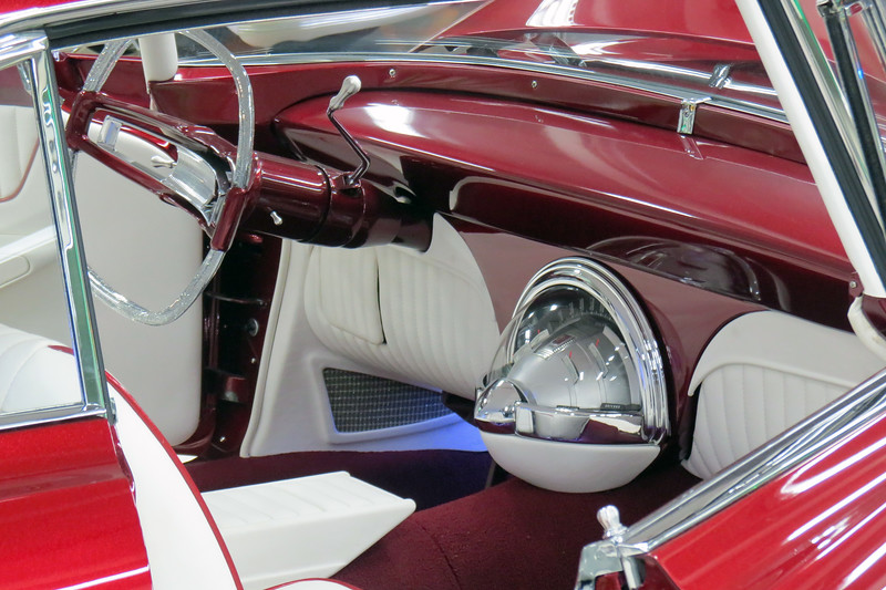 Modifications continue to the interior.  Like the Golden Empress seen earlier, this car has modified seats from a 1964 Ford Thunderbird.  The center dome instrument cluster is from a 1960 Chrysler 300F.  And the steering wheel is from a 1961 Plymouth.