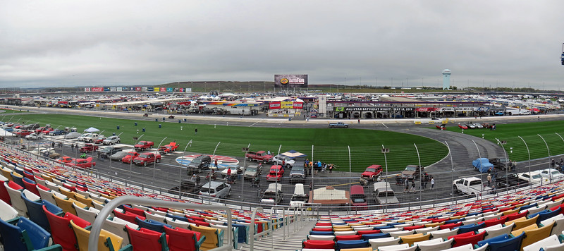 Two-picture panorama of the Charlotte Motor Speedway as seen from the grandstands along the front straight.