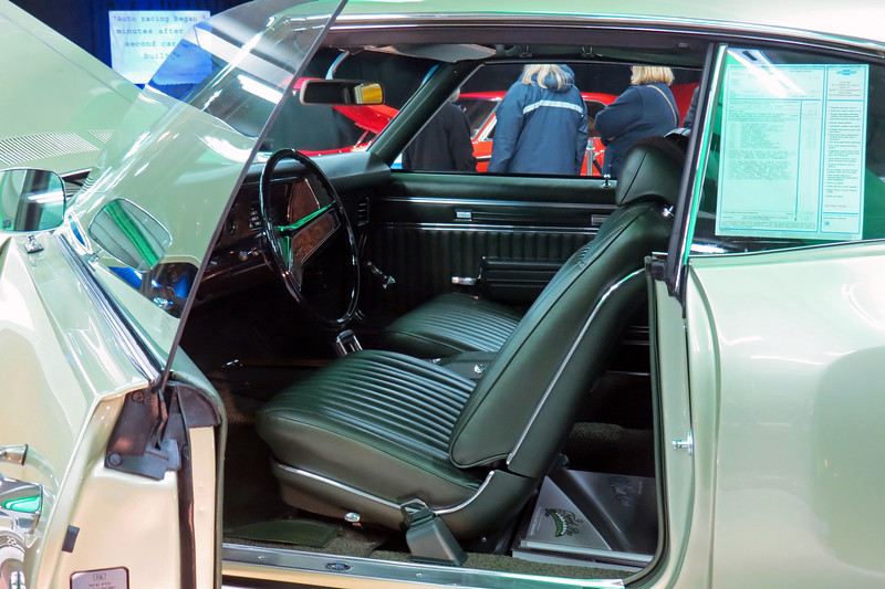 "The interior trim code 784 indicates ""Metallic Dark Green Coated Fabric,"" which the window sticker refers to as ""Dark Green Vinyl."""
