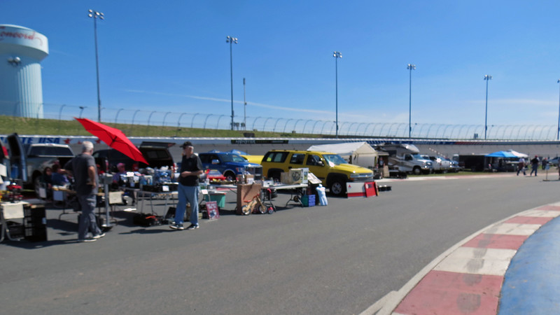 A blurry picture of some of the vendors in the infield.  The Car Corral, (i.e. cars for sale), was positioned on the track while the vendors were in the infield.