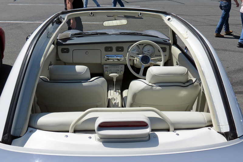 This design is known as a Fixed-Profile convertible because the center section of the roof retracts leaving the outline of the hardtop roof still in place.