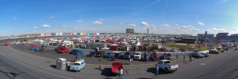 Three-picture panorama of the infield as seen from Turn 4.