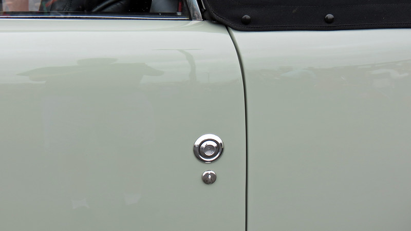 One of Gregorie's design objectives was to get people to focus on the styling of the car.  To accomplish this, much of the traditional chrome and brightwork that adorned cars from that era was intentionally omitted.  For example, the exterior door handles were replaced by pushbuttons.
