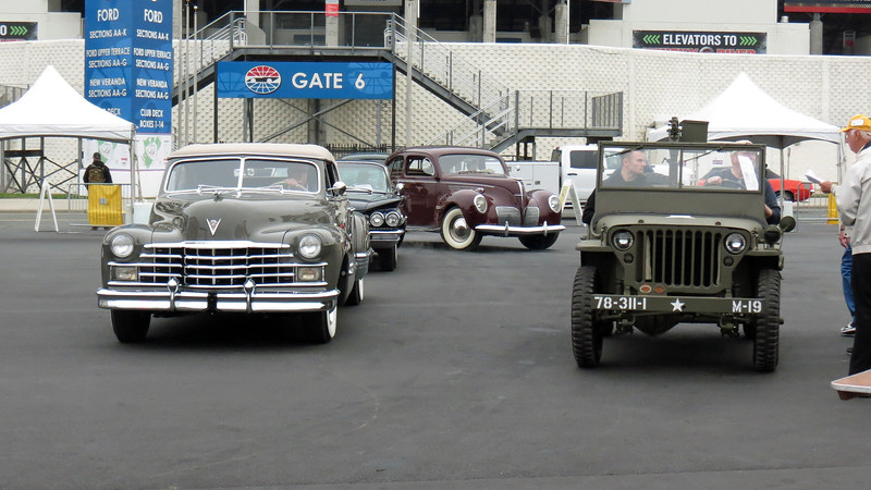 1947 Cadillac Series 62 convertible (L) and 1944 Willys Jeep (R).