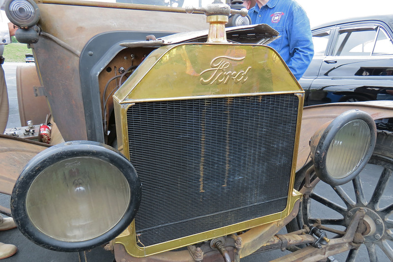 This car has a brass radiator.  Sometime during 1916, Ford switch from a brass radiator to a painted steel radiator.