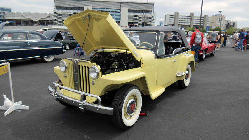 The Jeepster is actually a phaeton body, meaning a vehicle that doesn't have fixed weather protection.  A phaeton differs from a convertible in that a phaeton doesn't have roll-up windows, instead opting for detachable side curtains.