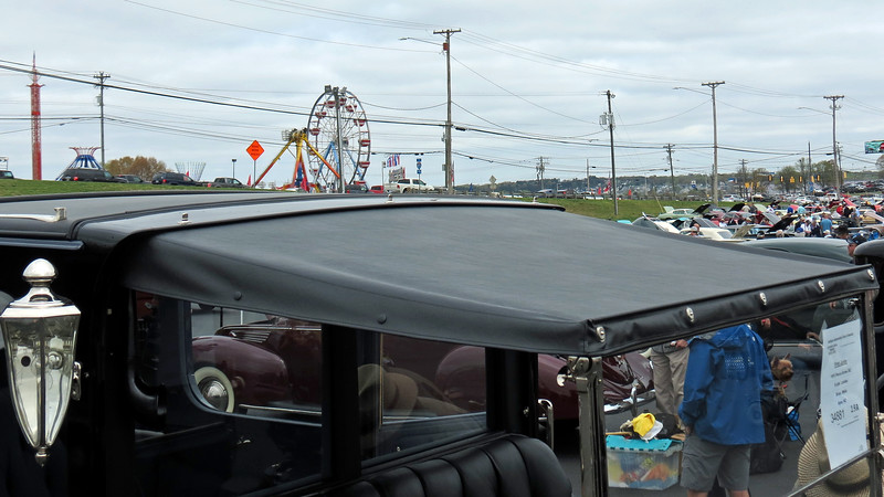 The driver's compartment is open and covered by a canvas roof.