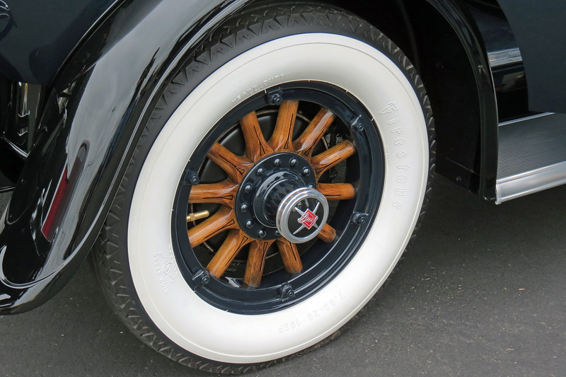 I love the details in the wooden-spoke wheels, especially the Buick logo.