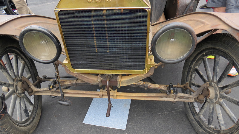 The hand crank in the photo above in the center of the car how the car was started.  The Model T's well known hand crank could break your wrist if you weren't careful.