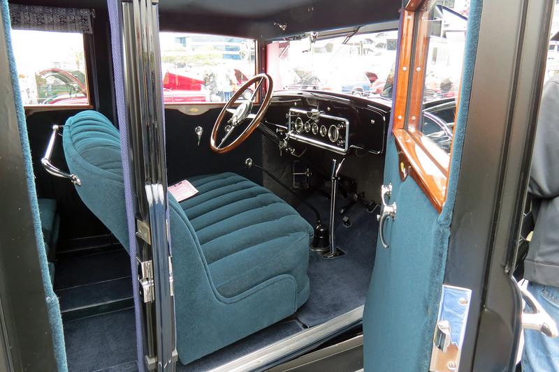 "The ""Series 129"" designation indicates the car's wheelbase of 129 inches.  the ""Model 50"" name indicates a 7-passenger, 4-door sedan body."