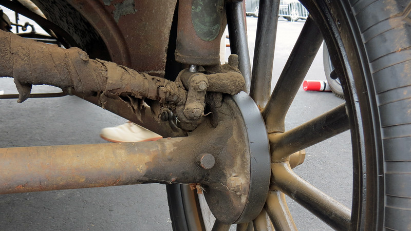 """The Model T's brake system is vastly different than what is seen today.  The photo above shows the right rear brake drum which is bolted to the wheel.  Unlike the 4-wheel brakes on a modern automobile, the Model T was equipped with brake drums on the rear wheels only.  But those brakes were known as """"Emergency Brakes"""" that were activated via the hand lever next to the driver.  Normal braking was done through the transmission."""