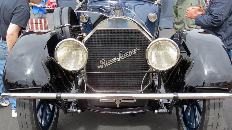 "The Pierce-Arrow trademark fender-mounted headlamps are not present on this car.  The ""lamps placed on mud guards,"" (as they were known at the time), had recently been introduced as an option.  The fender lamps gave the car its distinct appearance and made it instantly recognizable as a Pierce-Arrow.  The roles were reversed shortly thereafter, (the fender-mounted lamps became standard equipment and the traditional bracket-mounted lights became optional)."