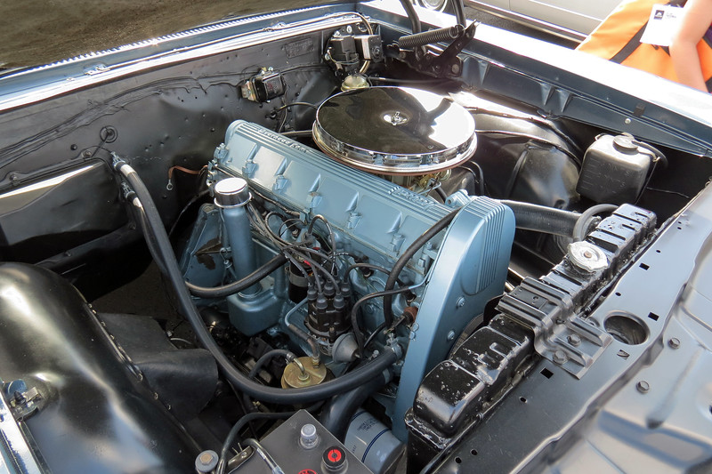 The belt-driven overhead cam arrangement was quite exotic for the time, and a first for the US market.  With a 4-bbl carburetor and 207 hp, it was also quite capable.