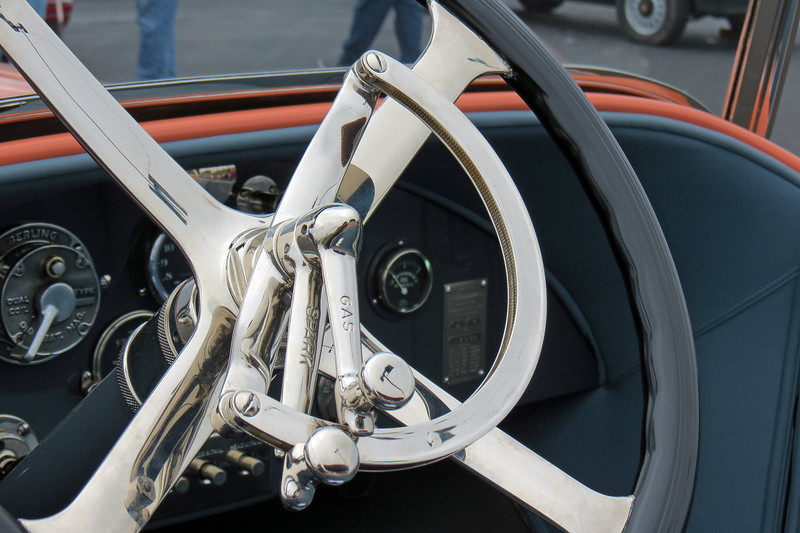 "The levers on the steering wheel are labeled ""Spark"" and ""Gas."""