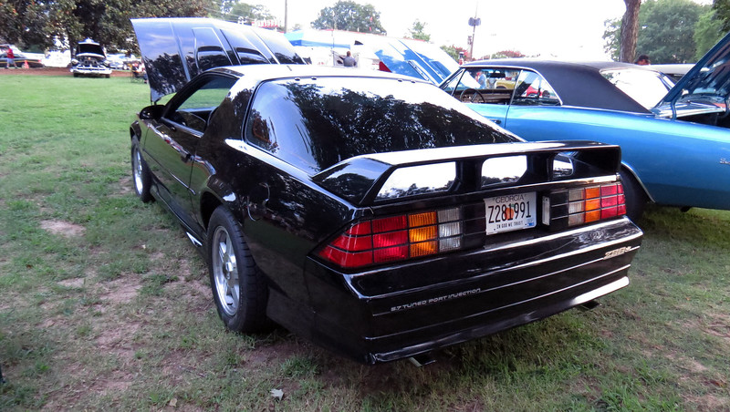 This car had the optional 5.7L V8.  I loved this car !  I had a '91 Z28 with the 5.7L V8 in Arrest-Me Red many years ago that would run 14.3s.  I won a trophy with that car.  Great memories !